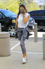 Alessandra Ambrosio Dons her usual workout ensemble for a business meeting in Beverly Hills
