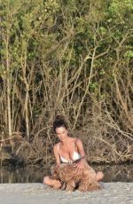 Alessandra Ambrosio Poses for a photo wearing a tiny two piece bikini in Florianopolis