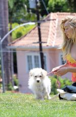 Alexis Ren Seen having a good time with her pup Angel in a local park in Los Angeles