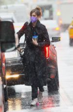 Anne Hathaway Spotted holding a cold beverage on a rainy day in New York City