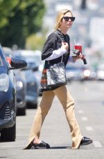 Ashley Benson Cools off with an iced tea on a blazing hot afternoon in Los Angeles