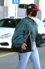 Bella Hadid Looks all casual and rather inconspicious as she arrives at Milan Airport