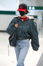 Bella Hadid Looks all casual as she arrives at Milan airport in Milan, Italy