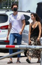 Camila Cabello Walks through a parking lot to have lunch together on a sunny afternoon in Miami