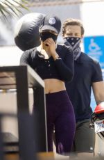 Cara Santana Exercises with her trainer using a medicine ball at Rise Nation gym in West Hollywood
