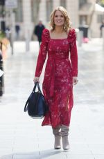 Charlotte Hawkins Look sensational in high split red dress and suede boots at classic fm in London