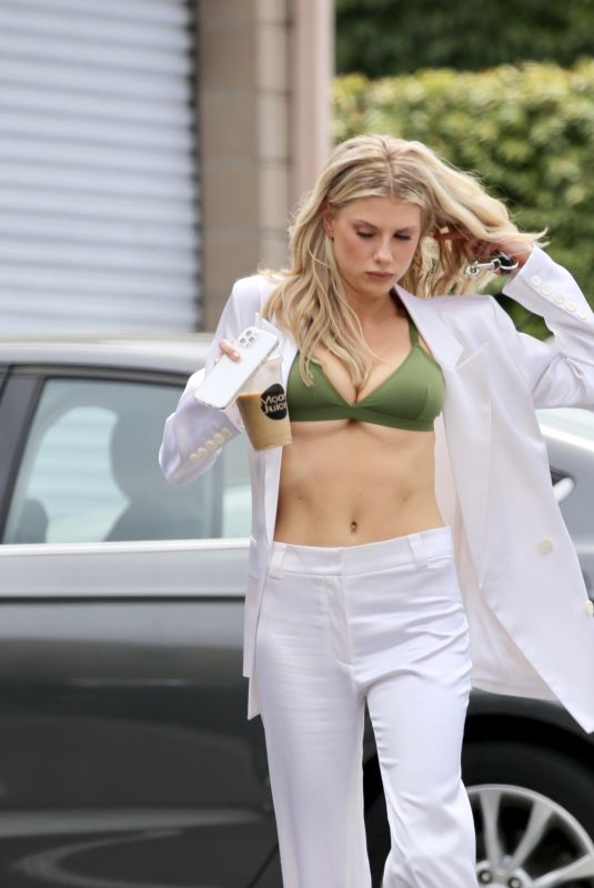 Charlotte McKinney Departing a photoshoot with her bra showing in Los Angeles