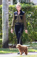 Devon Windsor Goes on a sunny morning walk in Coral Gables