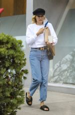 Diane Kruger Enjoys a cup of coffee after a session at a hair salon in Beverly Hills