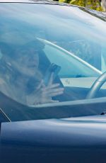 Ellen Pompeo Driving her Porsche while on the phone which is illegal in California