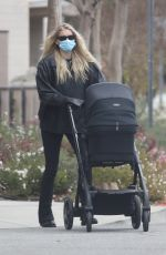 Elsa Hosk Heads out on a stroll with newborn daughter Tuulikki