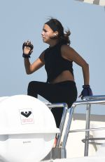 Eva Longoria Working out on a trampoline onboard a yacht in Miami