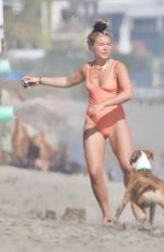 Florence Pugh In tight orange swimsuit on the beach in Malibu