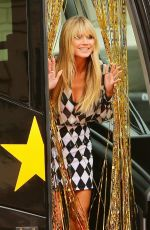 Heidi Klum All smiles as she takes the red carpet during an AGT special in Los Angeles