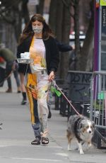 Helena Christensen and her dog go on a coffee run in NYC