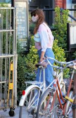 Helena Christensen Returns home in high-waisted jeans and pink top in New York City