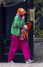 Iris Law Sport mirroring styles as she step out in brightly coloured ensembles in London