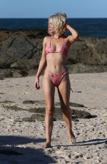 Jessika Power Showing off her sexy svelte physique in her pink picture as she poses on the Gold Coast