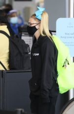 JoJo Siwa Seen with her parents as they catch a flight out of Los Angeles