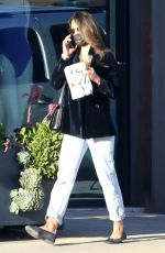 Jordana Brewster Looks all business as she picks up coffee in Los Angeles