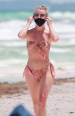 Julianne Hough Hits the beach again in a patterned bikini while enjoying a holiday with friends in Tulum