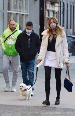 Kelly Bensimon Sports a fashionable look while carrying her dog in NYC