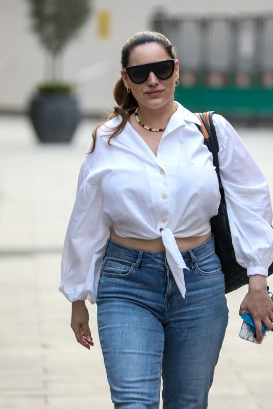 Kelly Brook Flashes a smile and her midriff as she is seen departing her Heart FM show at the Global Radio Studios in London