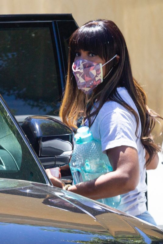 Kelly Rowland Reps Prince with a Purple Rain tee as she takes her son to a doctor