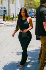 Kim Kardashian Loads up on goodies from Miami sex shop before catching flight back to LA