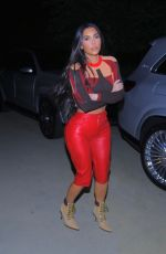 Kim Kardashian Looks stunning in flame-red pants as she leaves a friend