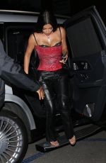 Kim Kardashian Rocks a red corset as she steps out to dinner with friends in Brentwood