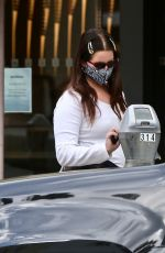 Lana Del Rey Feeds her parking meter as she goes shopping in Beverly Hills