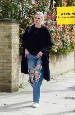 Lara Stone Make up free and sporting ripped jeans while out in London
