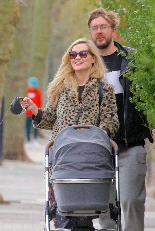 Laura Whitmore Out for a walk with boyfriend Iain Sterling and their newborn baby in London