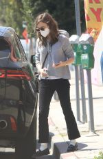 Lily Collins Picking up clothing from the dry cleaners in West Hollywood