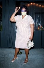 Lizzo Flaunts her curves in a pink and white striped dress while leaving dinner at Crossroads Kitchen in Los Angeles