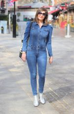 Lucy Horobin Flaunts sensational figure in a skin tight denim jumpsuit at Heart radio in London