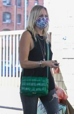 Malin Akerman Carries a few goodie bags as she arrives for a party on Easter Sunday in Los Feliz