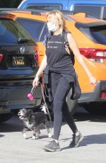Malin Akerman Shows off toned arms and brings her pup with her to a hike