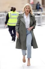 Mollie King Pictured in denim and green rain coat for BBC Radio appearance in London
