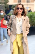Myleene Klass Looks hot yellow corduroy trousers at Smooth Radio in London