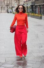 Myleene Klass Stuns in red trousers and orange ribbed top at Smooth radio Studios in London