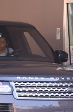 Nicole Murphy Stops by the bank to get some cash