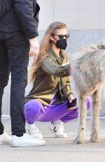 Nina Agdal Hangs with friends and dogs at Washington Square Park in New York City