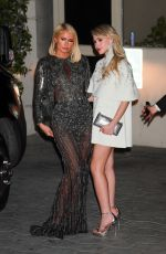 Paris Hilton & Maria Bakalova Cause a flash frenzy at the annual Oscar party at Sunset Tower Hotel in Los Angeles
