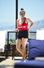 Rebecca Black In a skimpy red bathing suit at the Dream hotel pool party in LA