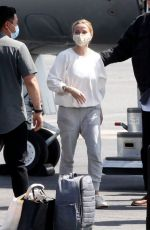 Reese Witherspoon Arrives in Los Angeles on a private jet with her son Deacon