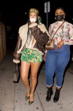 Rihanna Parties at The Nice Guy in mini skirt that showcases her slender legs in Los Angeles
