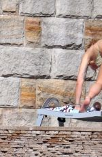 Rita Ora As she relaxes poolside wearing a bikini in Sydney, Australia