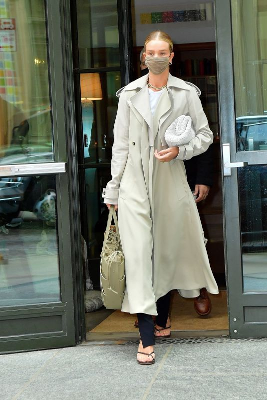 Rosie Huntington-Whitley looks stunning for breakfast as she gives our cameras her model face